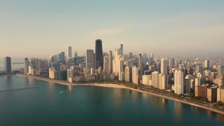 Aerial view of the Chicago, America early in the morning. Drone flying over the lake Michigan on the dawn.