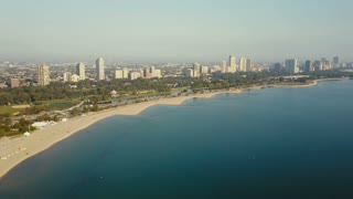 Aerial view of the Chicago, America on the dawn. Drone flying in parallel of the shore of the lake Michigan.