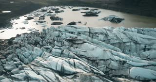 Aerial view of the glacier Vatnajokull in Iceland. Copter flying over the melting iceberg in mountains valley.
