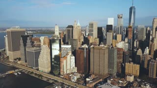 Aerial view of the Manhattan downtown in new York, America. Drone flying away from the city with skyscrapers.