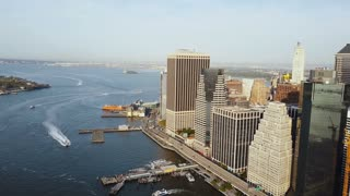 Aerial view of the Manhattan in New York, America. Drone flying away from the shore of East river, business part of city