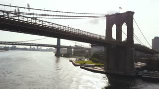 Aerial view of the New York, America. Copter flying under the Brooklyn bridge to Manhattan bridge through East river