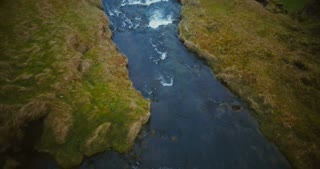 Aerial view of the river in the valley became a powerful waterfall Gljufrabui in Iceland. Tourist looking to sight.