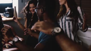 African American guy dancing with friends. Slow motion close up. Multi ethnic birthday party celebration. Friendship.