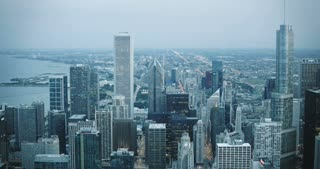 Amazing 4K aerial timelapse of Chicago USA evening. Skyscrapers near Lake Michigan. Sunset and twilight to darkness.