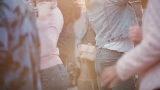 Amazing slow motion view of many people dancing in pairs, enjoying a Latin American open air dance party in the street.