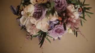 Beautiful elegant bouquet lying on the table. Fresh flower composition with poses and peonies.