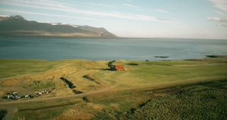 Beautiful landscape in the Iceland. Scenic view of the shore of the sea and house staying alone near the water.