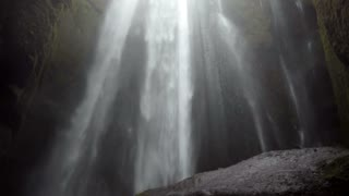 Beautiful landscape of powerful waterfall in Iceland. Stream of water falls down from the top of the mountain, splashing