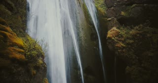 Beautiful landscape of the falling down from the mountain water. Scenic view of the Gljufrabui waterfall in Iceland.