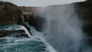 Beautiful landscape of the Gullfoss waterfall in iceland. Flow of water with foam and splashes falls down from the cliff