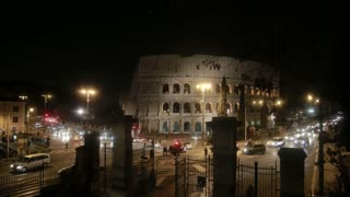 Beautiful panoramic view of the Coliseum in Rome, Italy. Famous historical building with lights in the evening.