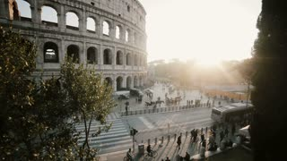 Beautiful panoramic view of the Colosseum in Rome, Italy. Sunset landscape with historical building. Stop motion.