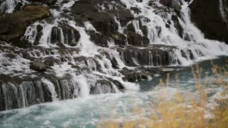 Beautiful scenic landscape in Iceland. Powerful waterfall Barnafoss cascades falls down and flows in river.