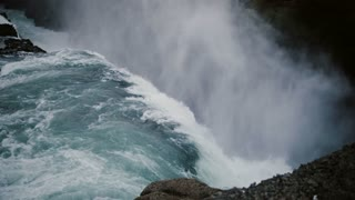 Beautiful scenic landscape of the Gullfoss waterfall in Iceland. Splashing water falling down from the cliff with foam.