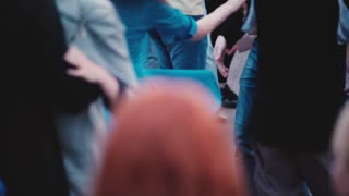 Beautiful slow motion view of many people dancing together at a Latino open air dance party in the street and having fun