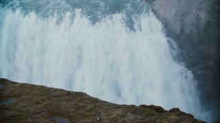 Beautiful view from the top of the mountain on the Gullfoss waterfall in Iceland. Water falls down from the cliff.