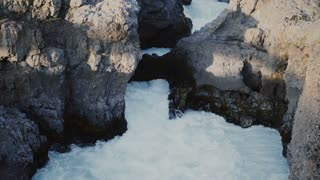 Beautiful view of wild river, powerful Barnafoss waterfall in Iceland. Water with foam falls between mountains.