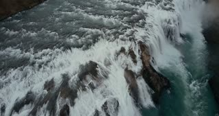 Beautiful wild waterfall Gullfoss from the copter. Aerial view of the turbulent flow in Iceland nature.