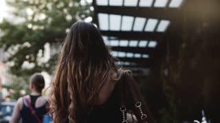 Camera follows confident European fashionable businesswoman walking along New York City downtown street slow motion.