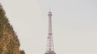 Camera moving down from the top of Eiffel tower in Paris, France - famous sight.