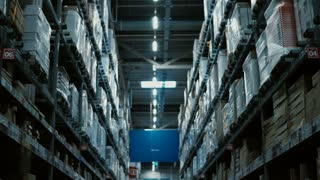 Camera moving through the big warehouse or shopping mall. High shelves with many of goods for repair around.
