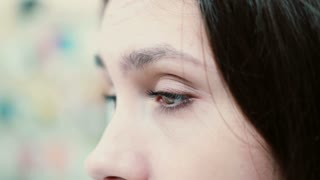 Close-up view of female eyes looking around. Sad worried woman.