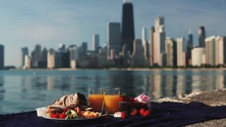 Close-up view of fruits and juice on the shore of Michigan lake in Chicago, America in sunny bright day.