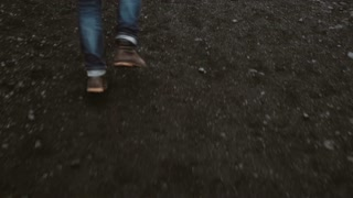 Close-up view of male foot wearing boots. Anxious man running away from somebody.
