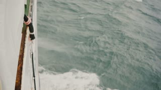 Close-up view of the board of the motorboat. White ship splashing the blue waters of the sea.