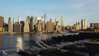 Drone flying from the Brooklyn, view on Manhattan in New York, America. East river, Governors island, statue of liberty.
