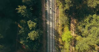 Drone top view of man running on train track. Concept of life never ending journey. Chasing dreams and surviving.