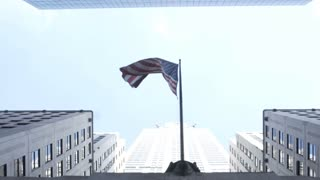 Elevated view of the skyscrapers and national american flag in New York. Office building and skyline in city center.