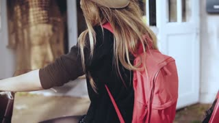 Female riding a bicycle with a red backpack. Slow motion extreme close-up. Camera tilt up and down. Woman on bike ride.