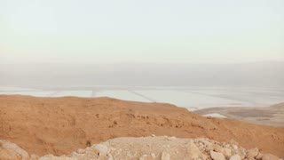 Girl at mountain view, jumping with arms wide open. Pretty European woman happy and excited. Happiness. Israel desert 4K
