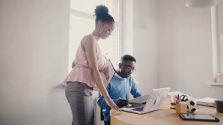 Happy black female manager inspires employees. Mixed ethnicity young smiling people work in modern loft trendy office 4K