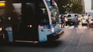 NEW YORK AUG 18 2017 - Camera moves sideways along two police officers controlling heavy traffic on a New York street.