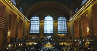 New York Grand Central station timelapse indoors 4K. Famous railroad terminal hall with people. Travel and tourism.