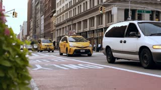 NEW YORK, USA, 18. 08. 2017 Traffic road in the downtown. Cars and yellows taxi riding through the city center.