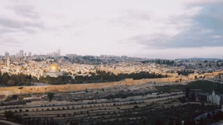 Panorama of old town Jerusalem, Israel. Panning left from Mount of Olives to ancient architecture religious buildings 4K