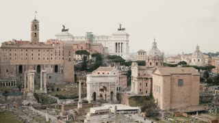 Panorama of Rome in Italy with Arch of Septimius Severus, antique monuments, columns, the House of Vestals.