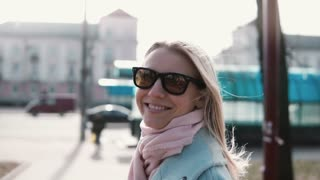 Portrait of cute Caucasian girl smiling at camera. Cheerful happy 20s lady laughing slow motion. Joy happiness concept.