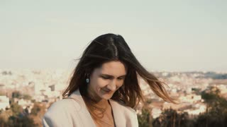 Portrait of happy smiling woman standing against the panorama of Rome, Italy. Female looking at camera, enjoying the day