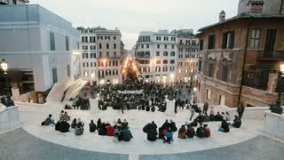 ROME, ITALY-29. 01. 2017 Stop motion of piazza di spagna in Rome, Italy. Crowd of people sit on stairs while getting dark