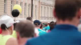 SAINT PETERSBURG RUSSIA, JULY 9 2017 - Back view of big crowd of people running at big city marathon event slow motion.