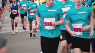 SAINT PETERSBURG RUSSIA, JULY 9 2017 - Close-up view of big crowd of people running at a big marathon event slow motion.