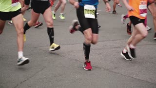 SAINT PETERSBURG RUSSIA, JULY 9 2017 - Legs and feet of professional runners in sport equipment at marathon slow motion.