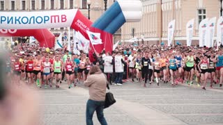 SAINT PETERSBURG RUSSIA, JULY 9 2017 - Start of a big city marathon. Large crowd of professional runners slow motion.