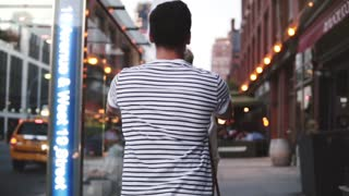 Slow motion happy romantic couple having fun bonding time together exploring beautiful streets of evening New York City.