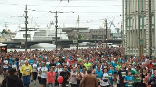 ST. PETERSBURG, RUSSIA - 09. 07. 2017. Big crowd running on road the marathon together. Men and women participate in race.